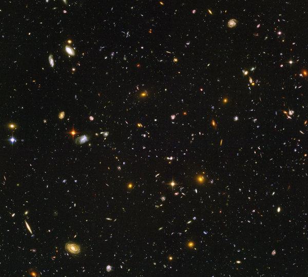 Фотография самой далекой  и старейшей галактики, расположенной за 12.8 биллион световых лет от Хаббла и космического телескопа Спитцер.