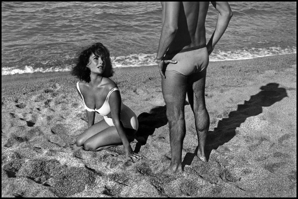 "SPAIN. Sagaro. 1959. Twenty-five-year-old Elizabeth TAYLOR on the set of ""Suddenly Last Summer"", in which she co-stars with Katharine Hepburn and Montgomery Clift.  It is Taylor's first film after the death of her 3rd husband, Mike Todd, in a plane crash. Just months after Todd's death, Taylor married Eddie Fisher and found herself at the center of a scandal. It was a place that would become familar for her, though never comfortable, for the next 30 years."